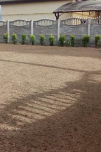 Планировка плодородной почвы под газон